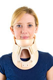 Blond Woman Wearing Supportive Neck Brace. Head and Shoulders Portrait of Young Blond Woman in Blue T-Shirt Looking Contented and Wearing Supportive Neck Brace Royalty Free Stock Images