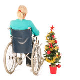 Blond woman in wheel chair while Christmas Royalty Free Stock Photos
