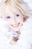 Blond woman with white boa Stock Photography