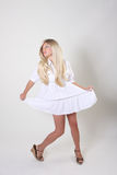 Blond woman in white dress Stock Photos
