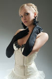 Blond woman in white dress and black  gloves Royalty Free Stock Photos