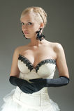 Blond woman in white dress and black  gloves Royalty Free Stock Images