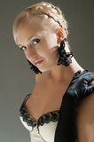 Blond woman in white dress and black  gloves Stock Photos