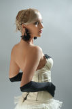Blond woman in white dress and black  gloves Royalty Free Stock Photography