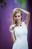 Blond woman in white dress Royalty Free Stock Photography