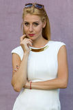 Blond woman in white dress Stock Image