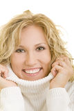 Blond woman in white sweater. Beautiful young woman in white turtleneck sweater or jumper, studio background royalty free stock photos