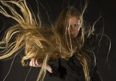 Blond Woman with Wind Blowing Through Long Hair Stock Photos