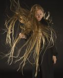 Blond Woman with Wind Blowing Through Long Hair Royalty Free Stock Photography