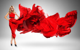 Blond woman in windy red dress Royalty Free Stock Photo