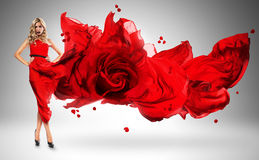 Blond woman in windy red rose dress Royalty Free Stock Photo