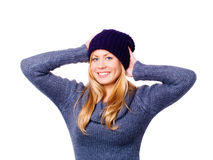 Blond woman in winter clothes over white Stock Images