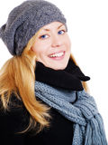 Blond woman in winter clothes over white Stock Photo