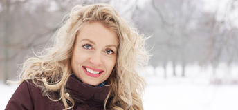 Blond woman in winter landscape banner. Blond woman in snow covered winter landscape. banner or header image with copy space Stock Image