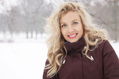 Blond woman in winter landscape. Blond woman in snow covered winter landscape Royalty Free Stock Image