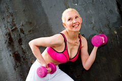 Blond woman working out Royalty Free Stock Photos