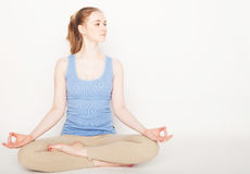 Blond woman working yoga exercise Stock Photo