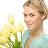 Blond woman with yellow tulips spring flowers Royalty Free Stock Images