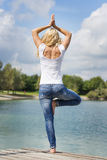 Blond woman yoga exercise Stock Photography