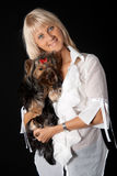 Blond woman with Yorkshire terrier. Royalty Free Stock Images