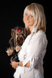 Blond woman with Yorkshire terrier. Royalty Free Stock Photos