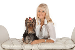 Blond woman with Yorkshire terrier. Stock Photo