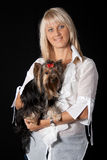 Blond woman with Yorkshire terrier. Royalty Free Stock Photography