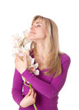 Blond womanl with orchid. Isolated on white Royalty Free Stock Photo