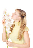 Blond womanl with orchid. Isolated on white Royalty Free Stock Photography
