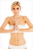Blond Women in Pray Yoga Pose. Thin blond girl in pray yoga pose. Isolated on white studio background Stock Photo