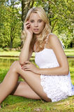 Blond wonam in the garden Stock Images