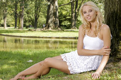 Blond wonam in the garden Royalty Free Stock Photos