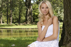 Blond wonam in the garden Stock Photography