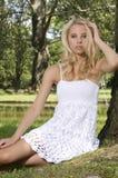 Blond wonam in the garden Stock Photos