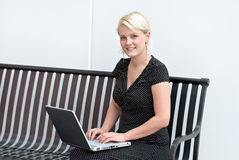 Blond Working on Computer Stock Images