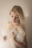 Blond wrapped in white veil. Blond woman wrapped in white veil royalty free stock photography