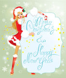 Blond xmas Girl wearing Santa Claus suit staying behaind frame. With handwritten text Marry Christmas and Happy New Year Royalty Free Stock Images