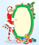 Blond xmas Girl wearing Santa Claus suit staying next to frame. Christmas and New Year card design Stock Photography