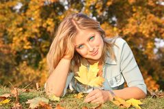 Blond with the yellow leaf Stock Image