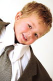 Blond young Boy in oversize business clothes Stock Photos