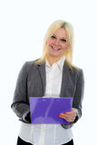 Blond young business woman with a clipboard Stock Image
