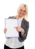 Blond young business woman with a clipboard Royalty Free Stock Photography