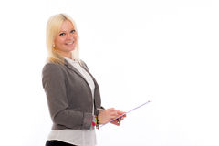 Blond young business woman with a clipboard Stock Photo