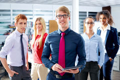 Blond young businessman multi ethnic teamwork Royalty Free Stock Images