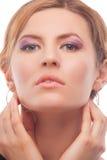 Blond young caucasian woman with vivid face makeup Stock Photos