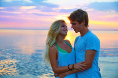Blond young couple hug in sunset sea lake happy Royalty Free Stock Image