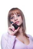 Blond young girl with a bottle of perfume Royalty Free Stock Photo