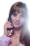 Blond young girl with a bottle of perfume Royalty Free Stock Photos