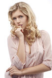 Blond young girl with curly hair with royalty free stock photos
