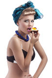 Blond young girl eating sweet Stock Photography